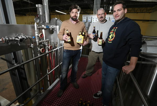 Andres Araya (L), brew master John Hall and Isaac Showaki (R), are pictured at their 5 Rabbit brewery in Bedford Park.