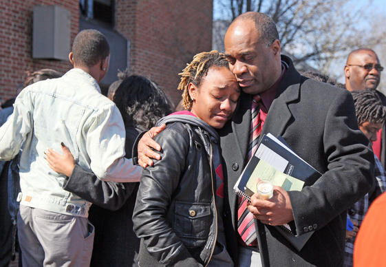 Alverne Chesterfield, Assistant Vice President, comforts a student in mourning after the vigil for UMES students Edmond St. Claire and Dickson Muiruri at the Ella Fitzgerald Performing Arts Center, Wednesday afternoon. at the Ella Fitzgerald Performing Arts Cente