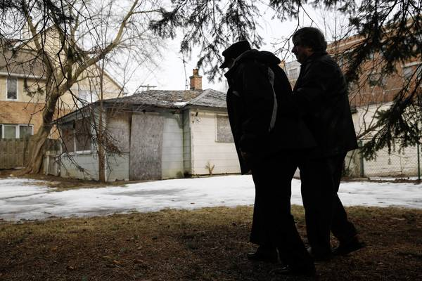 Paul Diambri, right, walks his dad, Pete Diambri, 87, out to his former rental properties along McGovern Avenue in Highland Park on Monday, Feb. 18, 2013.