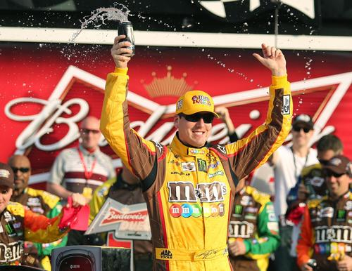 Kyle Busch celebrates in Victory Lane after winning the Budweiser Duel #2 at Daytona International Speedway in Daytona Beach on Thursday, February 21, 2013.
