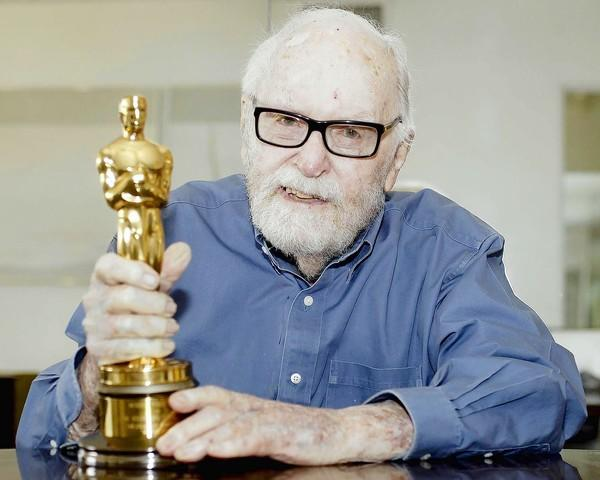 "Gene Allen, 94, of Newport Beach, with his Academy Award for color art direction of ""My Fair Lady."""
