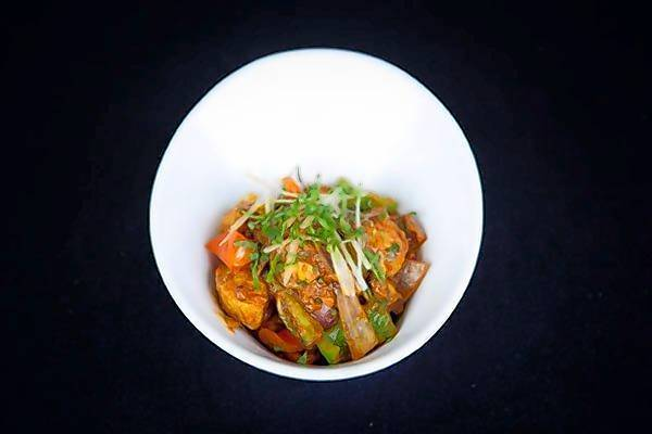Dhaba chili chicken is a pleasantly peppery mix from the appetizer menu.