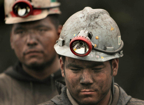 Coal miners walk from the Pasta de Conchos coal mine in 2006 after working in rescue efforts for 65 miners who were trapped by an explosion in San Juan de Sabinas, Coahuila, Mexico.