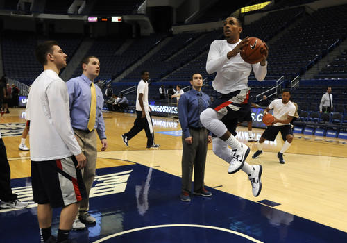 UConn guard Brendan Allen sails during warm-ups. The Huskies played the Bearcats Thursday night at the XL Center.