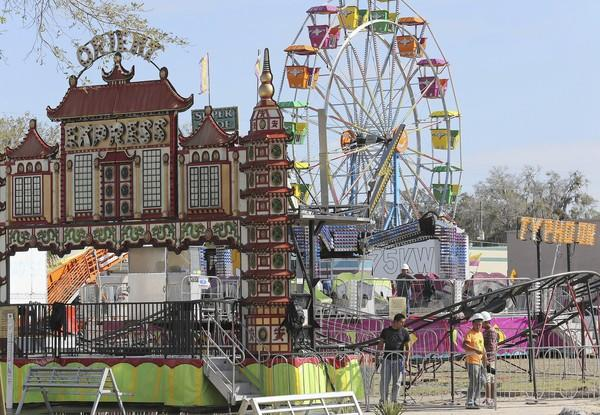 GeorgeFest organizers set up the midway earlier this week in Eustis. The annual event opens today in Ferran Park.
