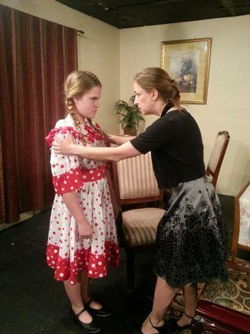 "Christine (Jennifer Rea, right) takes a long, hard look at her daughter (Katie Mecca) in ""The Bad Seed."""