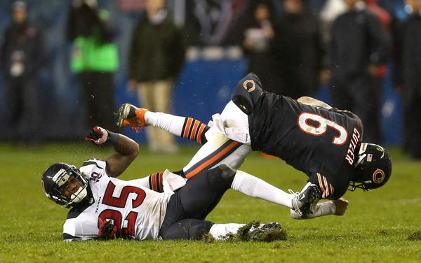 Bears quarterback is hit by Houston cornerback Kareem Jackson in November. Cutler had to leave the game at halftime and sat out the next game with a concussion.