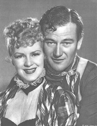 Claire Trevor and John Wayne.