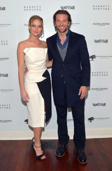 "Jennifer Lawrence and Bradley Cooper attend the Vanity Fair, Barneys New York and Weinstein Co. celebration of ""Silver Linings Playbook"" in support of the Glenholme School on Wednesday in Los Angeles."