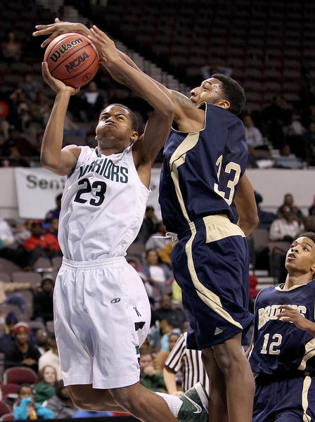 Gregory Alexander of Kecoughtan gets the shot past Jashad Jamison during the seocnd half of their Eastern Region Tournament game in Norfolk Thursday.