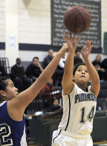 Providence's Estelle Glorioso takes a three point shot during the second quarter of their CIF Division V-AA quarterfinal girls' basketball playoff game against Bishop Union at Providence High School on Wednesday, Feb. 20, 2013 in Burbank, Calif.