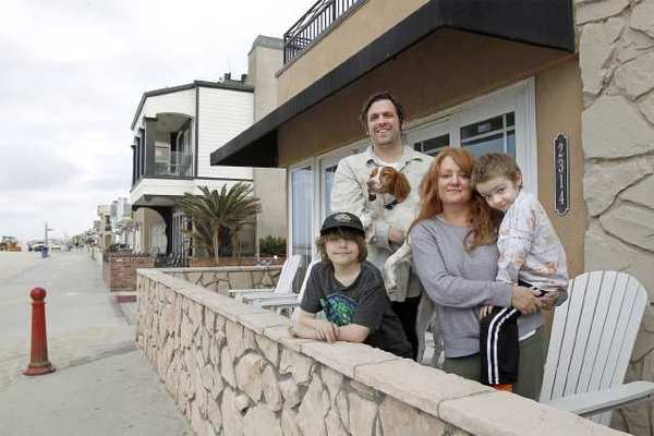 Make-A-Wish Foundation recipient Dashiell Codd, 5, of Iowa, far right, with his mother Pam, father Brian, brother Sumner, 8, and family dog Cider at a beach house in Newport Beach on Thursda.  Codd is currently battling liver cancer.