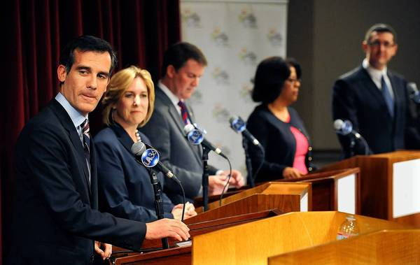Mayoral candidates, from left, Eric Garcetti, Wendy Greul, Kevin James, Jan Perry and Emanuel Pleitez debate at Loyola Marymount University.