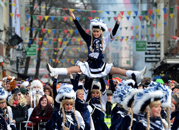 People celebrate in the streets of Dusseldorf, Germany, during the Rose Monday parade.