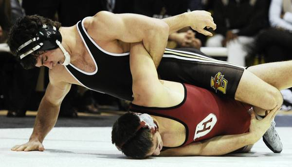 Lehigh's Robert Hamlin, top, holds the arm of Harvard's Josh Popple during the 184-pound weight class as Lehigh hosted Harvard, then Brown Sunday February 10, 2013.