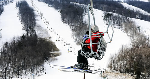 Skiers make their way to the top of a trail on a ski lift Wednesday at Whitetail Ski Resort in Mercersburg, Pa.