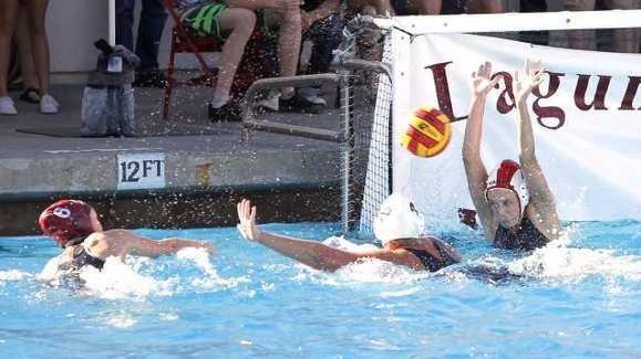 Laguna Beach High's Natalie Selin shoots and scores past Newport Harbor goalie Cleo Harrington.