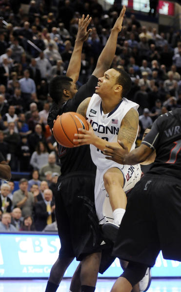 Shabazz Napier splits the Cincinnati defense to make the layup and take the game into overtime. UConn went on to win 73-66, with Napier scoring a game-high 27 points.