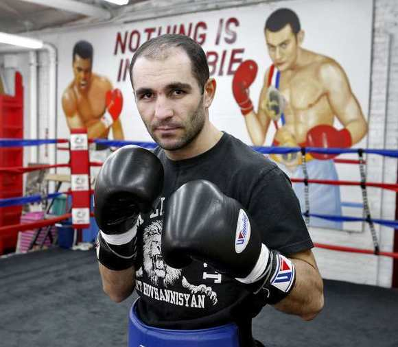 Boxer Art Hovhannisyan prepares for a training session at the Glendale Fighting Club.