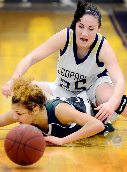 South Hagerstown's Chelsey Scott, bottom, gets on the floor to go after a loose ball under Smithsburg's Sarah Duckworth during Thursday night's MVAL Antietam girls basketball game.