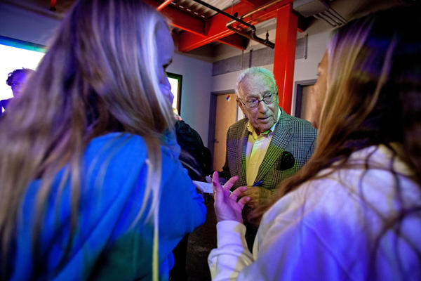 David Perlman interviews students at the Exploratorium. He was born in 1918, a decade before the discovery of penicillin. Pluto had yet to be discovered, let alone demoted.