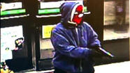 The robbery of a convenience store in Elmwood Park Monday is believed to be the work of a man wearing a Spider-Man ski mask who also has robbed three stores on Chicago's Northwest Side, authorities said.