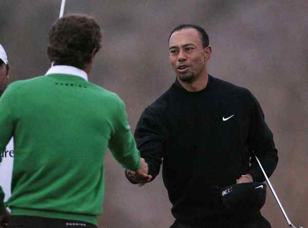 Tiger Woods shakes hands after losing 2 and 1 to Charles Howell III at the Match Play Championship.