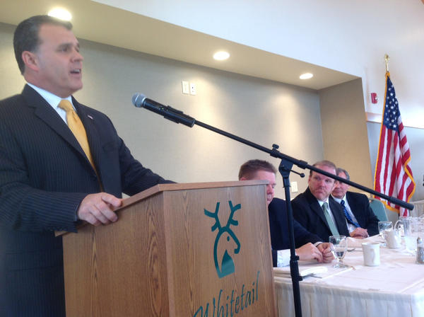 State Rep. Todd Rock, R-Franklin, addresses a Tuscarora Area Chamber of Commerce crowd Thursday morning. Seated from left are state Sen. Richard Alloway, Jim Frank from U.S. Rep. Bill Shuster's office and state Sen. John Eichelberger.