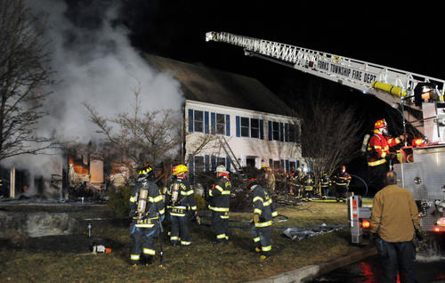 Heavy smoke pours from a garage fire that spread to the house at 40 Clarendon Drive, Forks Township on Thursday night. The fire, which began about 7:30 p.m., brought out firefighters from Forks Township, Palmer Township, Lower Mt. Bethel, Plainfield Township and West Easton. The home is reportedly owned by Lucas Taylor.