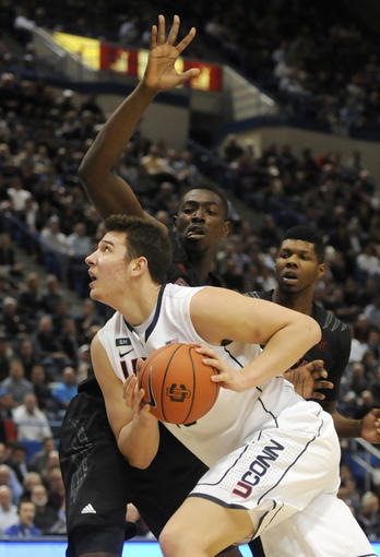 UConn's Tyler Olander turns on Cincinnati center Cheikh Mbodj in the second half. Both players finished with four points. UConn won 73-66 in overtime.