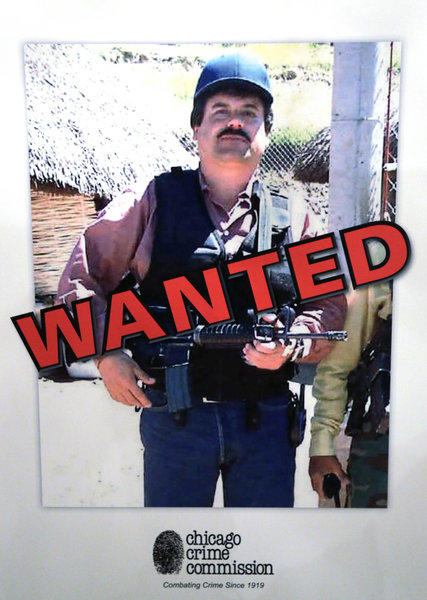 "Poster of Joaquin ""Chapo"" Guzman was displayed at a Chicago Crime Commission news conference Feb. 14 in Chicago, where the reputed Mexican drug kingpin was deemed Chicago's Public Enemy No. 1, the first time the designation has been used since Prohibition, when the label was created for Al Capone."