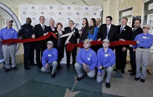 "With city officials and members of the Downtown Glendale Association present at the Alex Theater in Glendale, DGA president Rick Lemmo cut the ribbon for the newly formed ""Ambassadors"" group. The ambassadors will roam downtown helping visitors with directions and information, and to help keep the city clean."