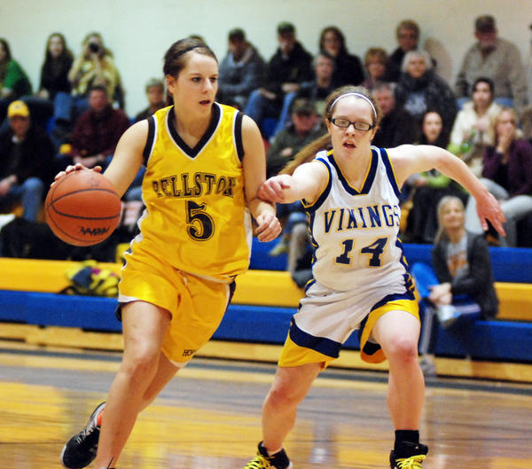 Pellston junior guard Kelly Lewis (left) looks to drive on Alanson senior Jodie Tanner Thursday at the Alanson High School gym.