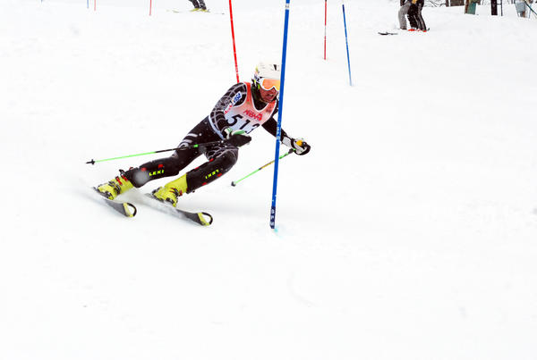 Petoskey senior Brian Erhart won the giant slalom twice Thursday as the Northmen boys claimed the Big North Conference title at Boyne Mountain.