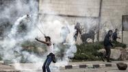 RAMALLAH, West Bank -- Palestinians demonstrated throughout the West Bank and East Jerusalem on Friday demanding the release of four prisoners on a hunger strike in Israeli jails.