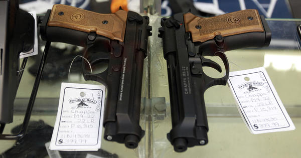 Handguns are displayed in the glass case at Freddie Bear Sports in Tinley Park, Ill. in January.