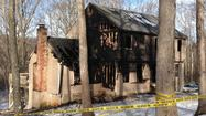A man who along with his wife was seriously injured in a fire early Friday that heavily damaged a home at 19 Beaver Dam Trail has been arrested on several charges, police said.