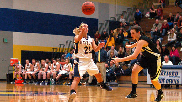Gaylord's Sarah Polena makes a pass during an earlier contest. In Thursday's 53-38 victory over Cadillac, Polena notched 10 points, 4 assists and 3 steals.