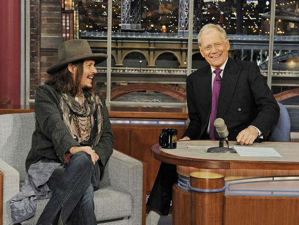 """Lone Ranger"" star Johnny Depp, left, joins host David Letterman the set of the ""Late Show with David Letterman."""