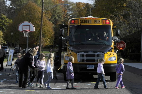 Students at the Hanmer Elementary School in Wethersfield are shown how to exit a school bus aspart of National School Bus Safety Week.