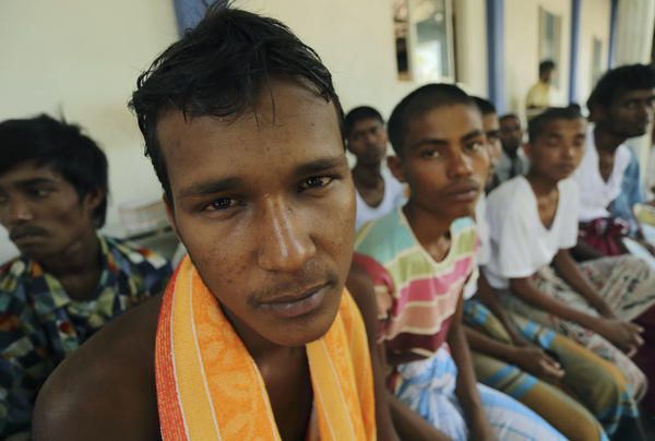 Rescued Rohingya Muslims sit at a Sri Lankan immigration detention center in Colombo on Wednesday.