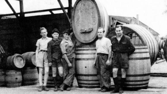 Betty Spaltensperger's father had a lucrative career as a barrel maker before World War II. Her brother Joschi, wearing a white shirt, is on the far left and her father, Heinrich, also in a white shirt, is on the left.