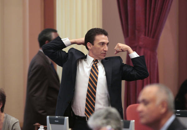 State Sen. Michael J. Rubio (D-Shafter) stretches during a lull in the legislative action at the Capitol last year. He announced his resignation on Friday.