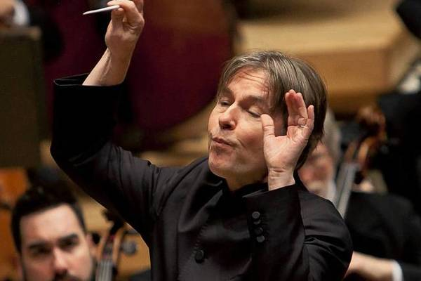 Esa-Pekka Salonen conducts the Chicago Symphony Orchestra as they perform prelude to act 1 of Tristan and Isolde at the Symphony Center on Thursday.