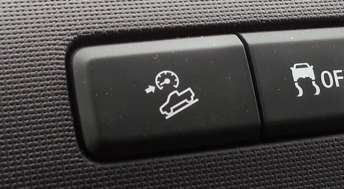 A 2013 Ford F-150 button has a tiny tachometer and arrow pointing at the low end of the engine's rev range. Going slow is part of the button's function, but not to spoil the fun of a twin-turbocharged V-6.