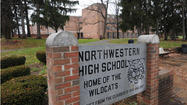 Northwestern High alumni sue school system over closure
