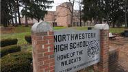 Northwestern High alumni sue school system over closure
