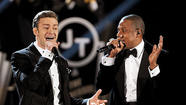 NEW YORK (Reuters) - Rapper Jay-Z and Justin Timberlake are teaming up for a 12-city summer stadium tour that will include concerts in New York, Los Angeles, San Francisco and Chicago, music promoter Live Nation said on Friday.