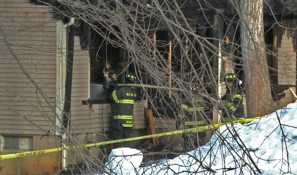 Old Saybrook firefighters using handlines try to extinguish hot spots in the home.