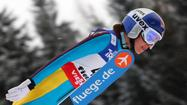 Sarah Hendrickson, an 18-year-old from Park City, Utah, has won the women's ski jumping title at the Nordic world championships in Val di Fiemme, Italy.